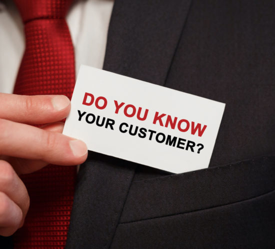 Businessman putting a card with text Do you know your customer in the pocket