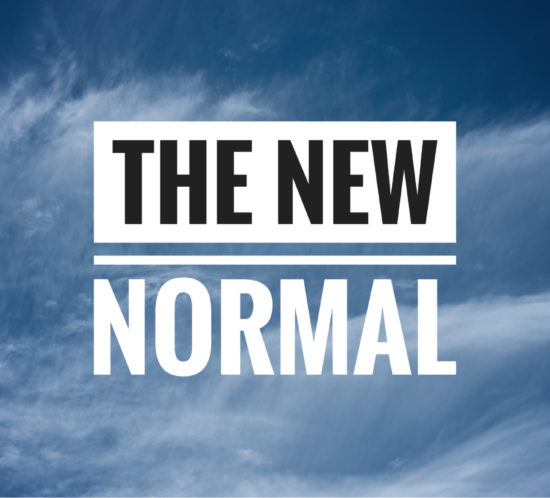 The New Normal written against blue sky