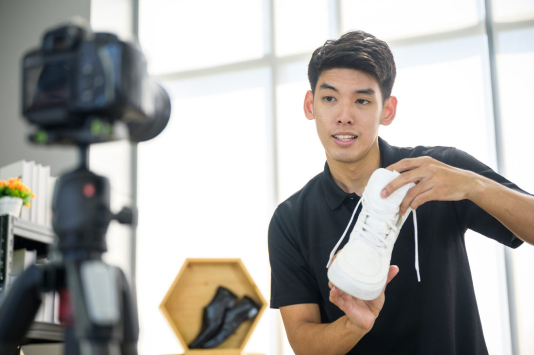 Social media influencer reviewing fashion shoe.