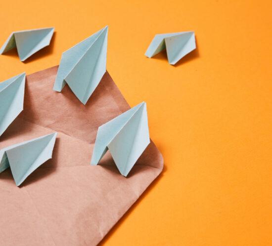 Paper planes on brown envelope