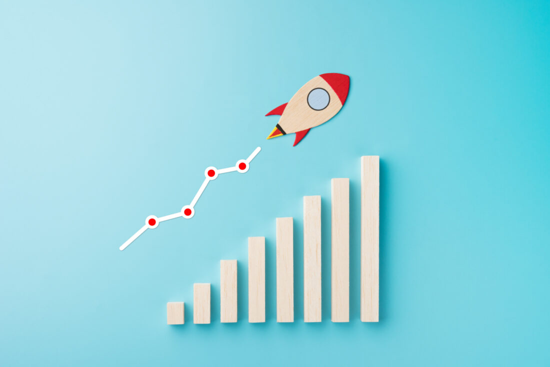 Rocket and chart on blue background business financial start up growth success concept object design