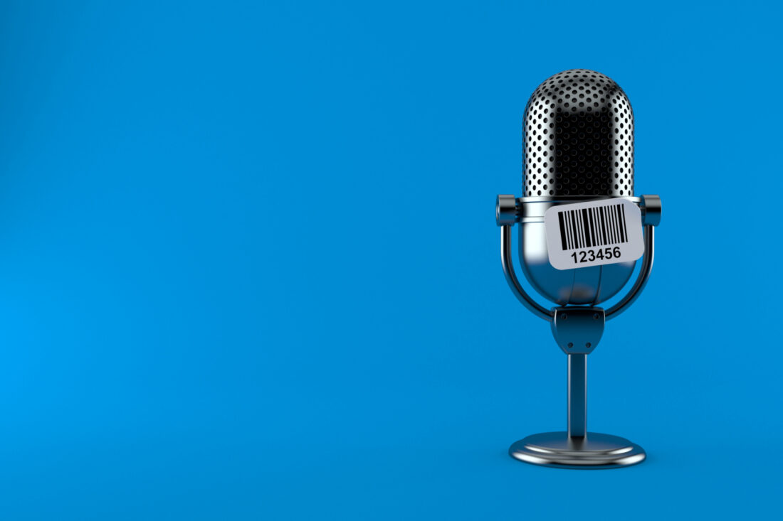 Radio microphone with barcode sticker isolated on blue background.